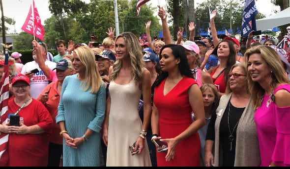 Pam Bondi, Lara Trump and Katrina Pierson take photos with a crowd estimated at 400 during a Women for Trump bus tour stop in Port Orange on Wednesday, Sept. 16, 2020.