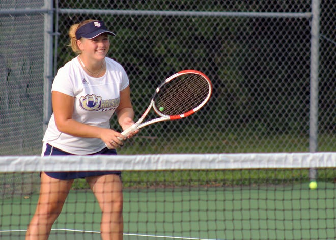 William Chrisman senior Kiara Ashurst smiles during the Bears' match against Truman Tuesday. Ashurst has verbally committed to Bethel College, making her the first Chrisman player to earn a college tennis roster spot in some time.