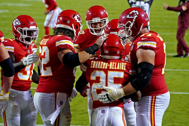Chiefs offensive linemen Austin Reiter (62) and Mitchell Schwartz (71) and tight end Travis Kelce, back, congratulate running back Clyde Edwards-Helaire (25) after scoring a touchdown against Houston in the season opener. The offensive line, despite several personnel changes, performed well in the Chiefs' 34-20 win.