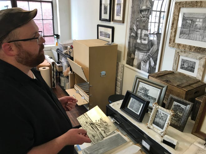 Blue Springs resident Brad Ultican discusses his artwork in front of a pencil portrait he created of Kansas City quarterback Patrick Mahomes. The Mahomes drawing was one of Ultican's first portraits as he is well known for his detailed pencil work that often highlights familiar Kansas City scenes and images from some of the 37 national parks he has visited.