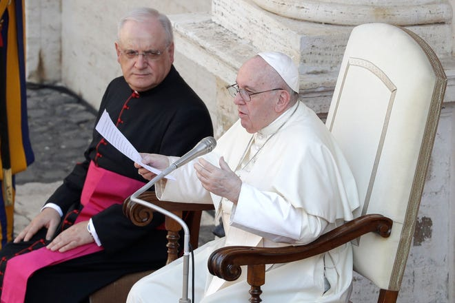 Pope Francis delivers his message Wednesday in the St. Damaso courtyard on the occasion of his weekly general audience at the Vatican.