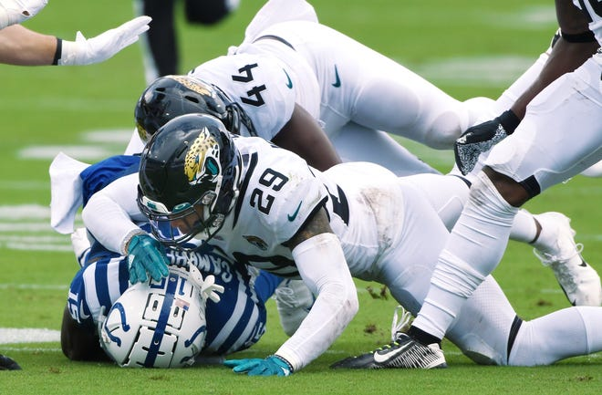 Jaguars safety Josh Jones (29) combines with Myles Jack (44) to stop Indianapolis wide receiver Parris Campbell during last week's 27-20 victory over the Colts at TIAA Bank Field.