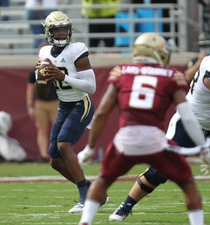 Georgia Tech quarterback Jeff Sims, a Sandalwood High School graduate, drops back to pass against Florida State in his college football debut on Saturday.