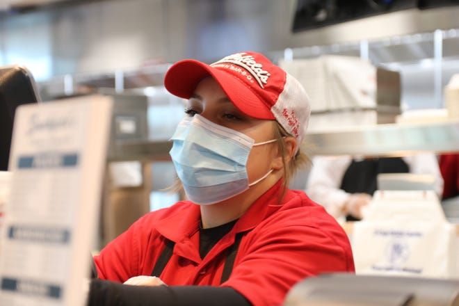 An employee waits on a customer at Smithfield's Chicken 'N Bar-B-Q, located at 4483 Hwy. 70, on the first day the restaurant opened in Kinston. [Brandon Davis/Kinston Free Press]