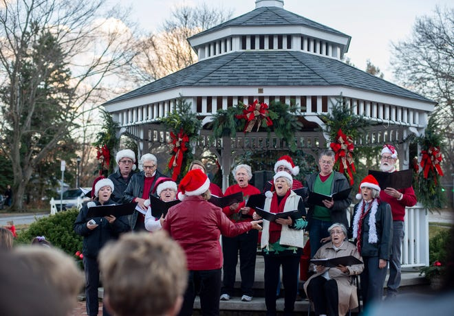 The Silver Lake Singers begin the annual Silver Lake tree lighting on Dec. 2, 2018.
