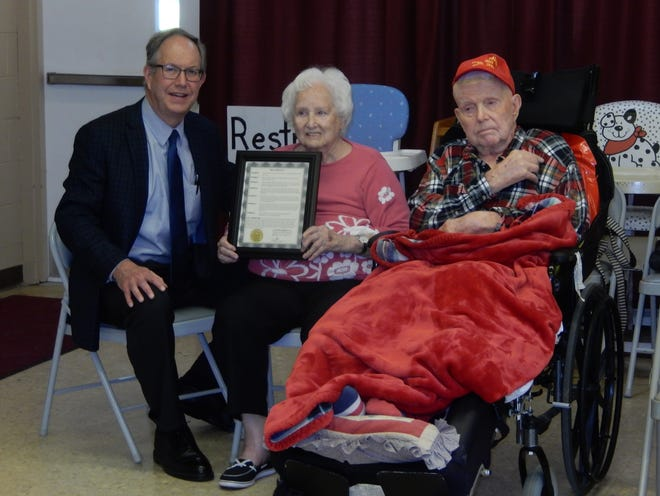 Mayor  John Pribonic, left, gave Jean and Charles Call a city proclamation honoring their 75th anniversary  in 2019.