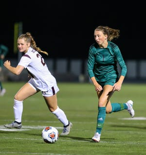 Nordonia senior Sam Wiehe runs past Stow-Munroe Falls's Addison McCoy during the Knights' 2-0 home win over Stow Sept. 16. Wiehe scored both goals in the win.
