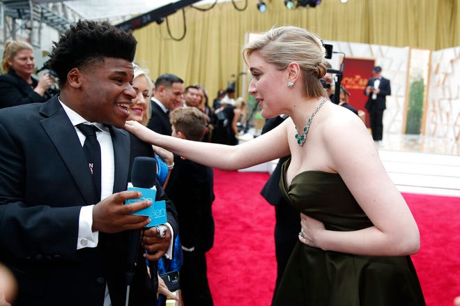 "In this Feb. 9, 2020, file photo, Greta Gerwig, right, talks to Jerry Harris on the red carpet at the Oscars at the Dolby Theatre in Los Angeles. Harris, the star of the Netflix documentary series ""Cheer,"" was arrested Thursday on child pornography charges."