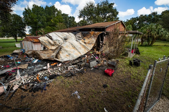 The remains of a mobile home at 266 Citrus Avenue destroyed by fire in Alturas early Sunday. The fire displaced a family of 7 who were renting at the time.