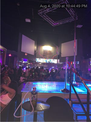 Playhouse 2 in West Plam Beach is packed with patrons not wearing masks on August 4 close to 11 p.m. The strip club should not have even been open. It was fined $7,000 Wednesday, the largest fine that has been levied so far in the county for a COVID-19 violation.