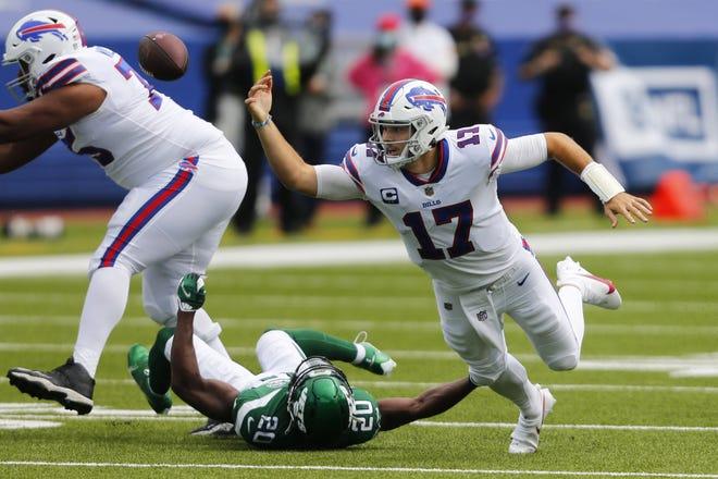 Bills quarterback Josh Allen fumbles Sunday against the Jets.