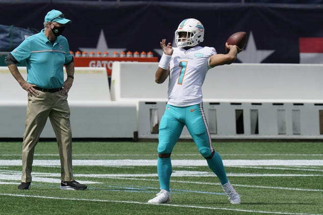 Miami Dolphins quarterback Tua Tagovailoa warms up before an NFL football game against the New England Patriots. [STEVEN SENNE/AP]