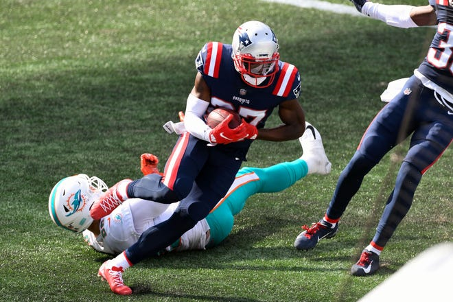 Patriots defensive back J.C. Jackson (27) intercepts a pass intended for Dolphins tight end Mike Gesicki (on ground) during last Sunday's game at Gillette Stadium, one of three interceptions tossed by Ryan Fitzpatrick in Miami's loss to New England.