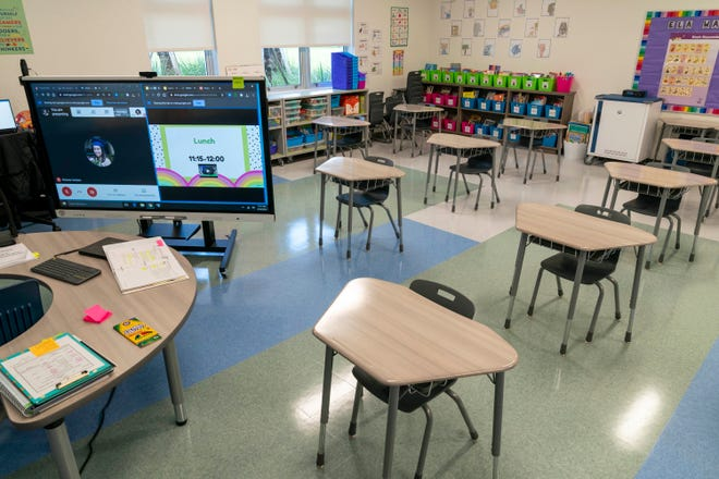 A classroom at Verde Elementary School in Boca Raton is set up to allow a teacher to work simultaneously with students online and in-person.  (GREG LOVETT/The Palm Beach Post)