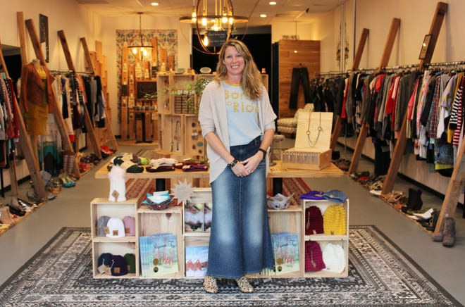 Karen Verdisco poses for a photo in her new upscale consignment shop located in Chesterfield on September 16, 2020.