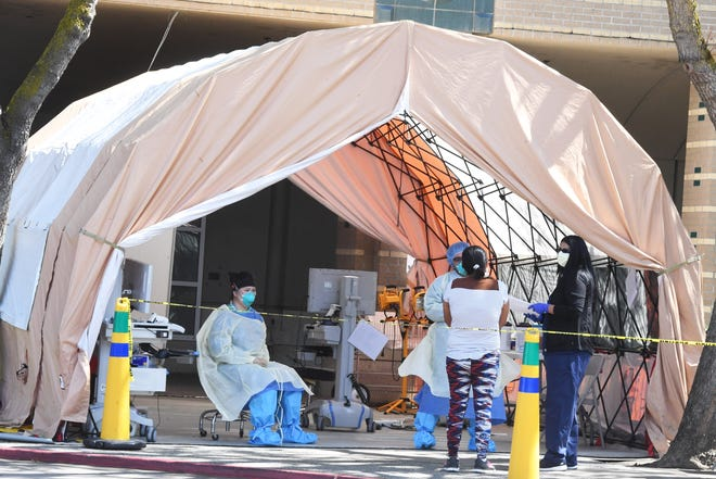 San Joaquin General set up tents in April as the hospital prepared for an increase of coronavirus cases in San Joaquin County. Thursday, the county's death toll topped 400.