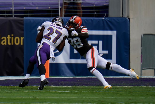 Cleveland Browns cornerback Terrance Mitchell is unable to keep Baltimore Ravens running back J.K. Dobbins (27) out of the end zone during the Browns' 38-6 loss on Sunday.