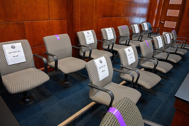 To ensure social distancing only jurors may only sit in seats marked with purple tape in the jury box in St. Johns County Circuit Judge Howard Maltz's courtroom in the St. Johns County courthouse.