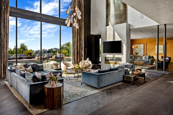 John Legend and Chrissy Teigen, who are expecting their third child, are asking $23.95 million for their contemporary home in the Beverly Hills Post Office area. Once owned by Rihanna, the multilevel house has been updated with cerused oak floors, hot-rolled steel walls and bespoke patterned ceilings from Thailand. Features of Legend and Teigen's home include a movie theater, a gym and a chef's kitchen. Three balconies overlook a saltwater swimming pool. (Anthony Barcelo/TNS)