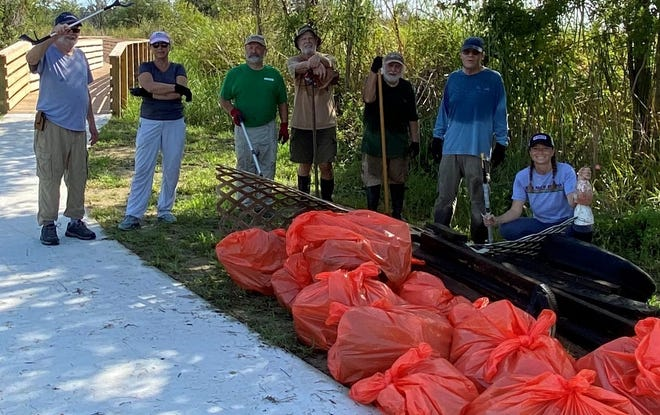 A group of eight community-minded volunteers from the Unitarian Universalist Fellowship of New Bern (UUFNB) spent an entire morning recently cleaning up the areas surrounding the brand new nature trail boardwalk at Lawson Creek Park. The result: dozens of bags of litter and other refuse were collected that had formerly been spoiling the gorgeous views of marshlands and wildlife at one of New Bern's premier recreational areas. Volunteers who pitched in are (from left to right) Sam Love, Terry Shoup, Michael Corr, Ed Toth, Fred Pittinger, UUFNB president Tom Shoup, and Christina Marshen. [CONTRIBUTED PHOTO]
