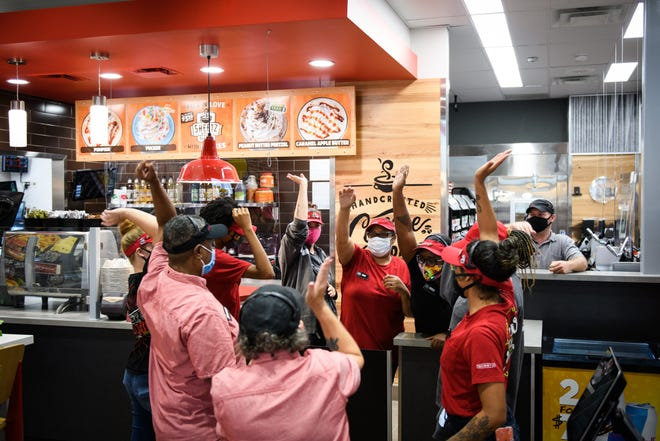 Sheetz employees do a cheer minutes before the store opens its doors for the first time in Fayetteville on Sept. 17, 2020.