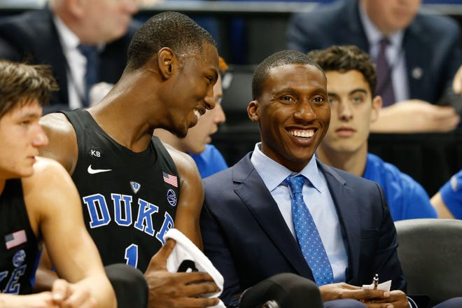 Dec 21, 2016; Greensboro, NC, USA; Duke Blue Devils forward Harry Giles (1) laughs with special assistant coach Nolan Smith during the first half against the Elon Phoenix at Greensboro Coliseum. Duke defeated Elon 72-61.