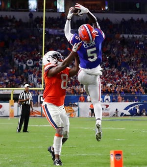 Florida defensive back Kaiir Elam (5) intercepts the ball away from Virginia wide receiver Hasise Dubois during the second half of the Orange Bowl on Dec. 30, 2019 in Miami Gardens. Florida won 36-28. [Brynn Anderson/Associated Press]