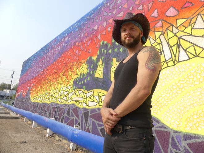 Artist Evan Meyer, co-founder of the nonprofit Beautify Earth, stands near his recently completed mural on Seventh Street in Old Town Victorville on Wednesday, Sept. 16, 2020.