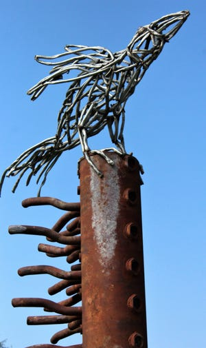 """A raven tops """"Messenger: Which Way Blows the Wind?"""" by Throckmorton metal sculpture artist Joe Barrington is in place on the north side of the Union Pacific tracks. It's his fifth presentation in the 40-year history of the Outdoor Sculpture Exhibition."""