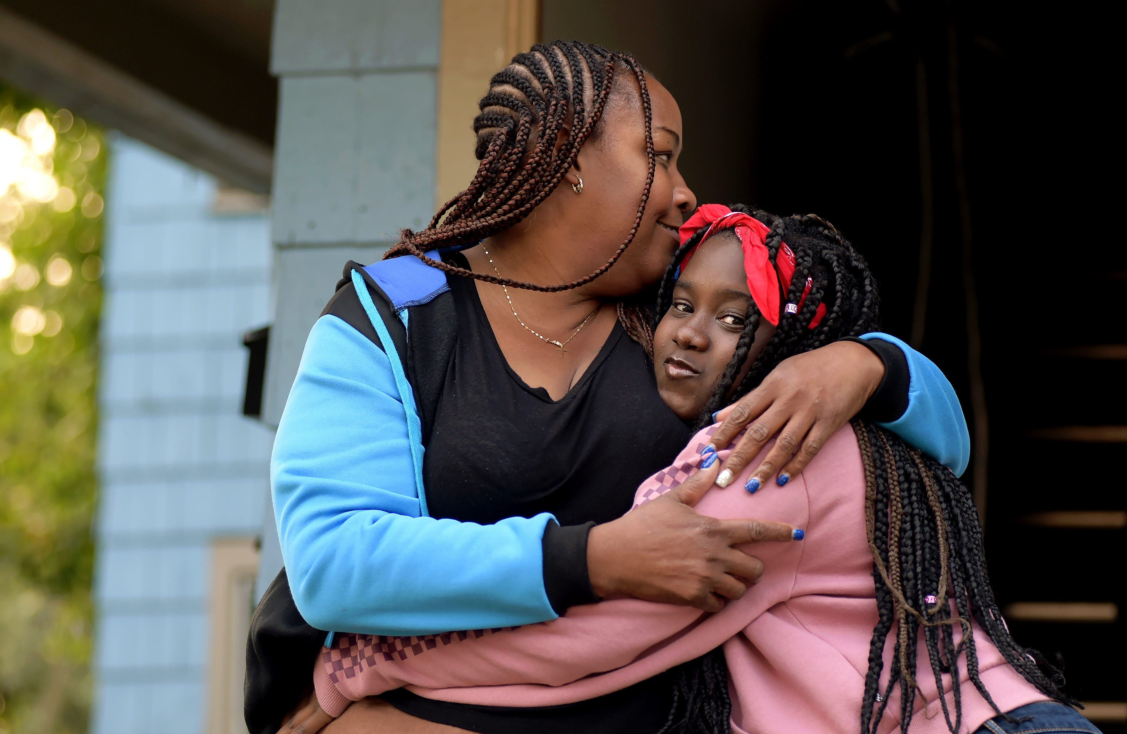 Davita Bateman with her daughter Raelin Powell, 12, in front of the family's Binghamton home. Bateman has opted for Raelin, an honor student at West Middle School who works well independently, to do the entire school year remotely. Tuesday, Sept. 15, 2020.