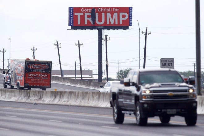 A Corpus Christi for Trump billboard shows vandalism on Thursday, Sept. 17, 2020 at North Padre Island Drive and Bates Road.
