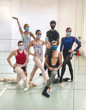 When Cincinnati Ballet returned to rehearsals on August 8, they were required to wear masks and limit their interactions to pre-arranged groups of dancers. Seen here are: front row, from left) Blair Bagley, Jacqueline Damico Amador, Taylor Carrasco and (rear row, from left) Abbey Gonzalez Kay, Luca De-Poli, Samantha Griffin.