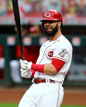 Cincinnati Reds left fielder Jesse Winker (33) reacts after striking out in the first inning of a baseball game against the Pittsburgh Pirates, Wednesday, Sept. 16, 2020, at Great American Ball Park in Cincinnati.
