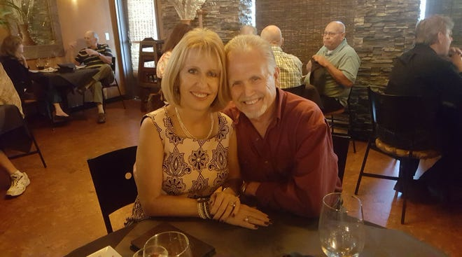 """After Ford bought back their defective 2013 Focus in August 2020, Elaine and Hershel Cecil celebrate with dinner in Lake Havasu, Arizona """"at the end of an unpleasant seven year experience.""""  Hershel said people need to know the Detroit Free Press was """"instrumental in bringing information to light"""" that helped thousands of families. """"People just need to be aware of the power and benefit of a free press,"""" he said."""