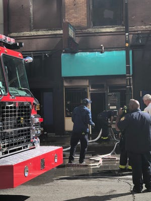 """Tip Toe Shoes, at141 Michigan Ave. next to Detroit's iconic American and Lafayette Coney Island,is a """"total loss"""" after a fire swept through the building Thursday afternoon."""