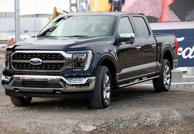 The 2021 Ford F-150 drives up during a news conference at the Dearborn Truck Plant in September.