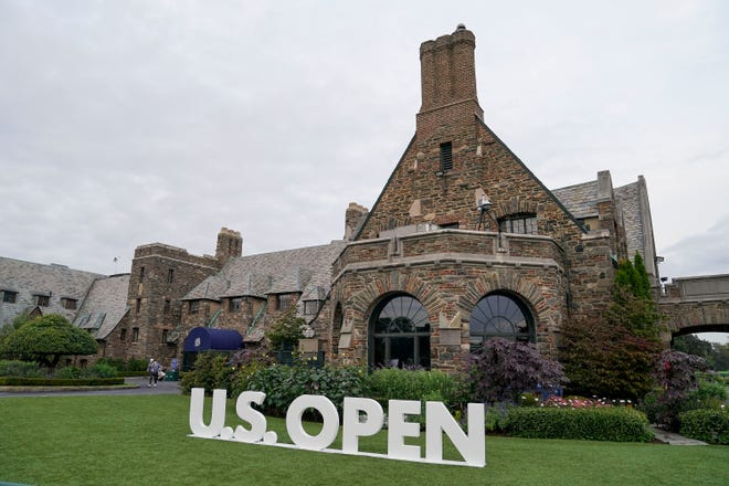Golfers walk out of the clubhouse at Winged Foot during the first round of the U.S. Open.