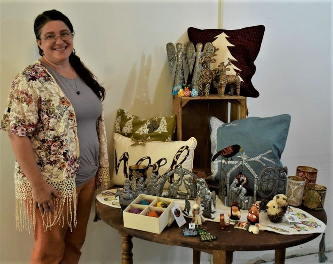 Christine Lehr stands with a few of the handmade Christmas items she will sell at her fair trade boutique, The Alabaster Jar Collective.