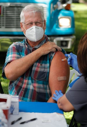 Fort Myers resident Michael Thomas receives a flu shot from nursing program specialist Marie George, Thursday Sept. 17, 2020, at a Fort Myers walk-up COVID-19 test site in Yawkey Park. The Florida Department of Health in Lee County began offering both free influenza (flu) and Hepatitis A vaccines at pop-up walk-up COVID-19 test sites. The flu vaccine is available to anyone age 6 months and older. Anyone not feeling well will not receive the flu vaccine. The Hepatitis A vaccine is available to anyone age 18 and older.