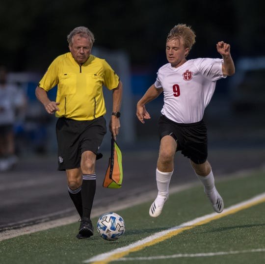 Scecina's Anthony Hentz (9) plays soccer and football for the Crusaders.