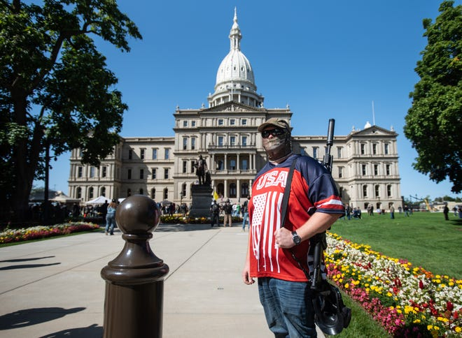 Yohann Deffert of Pierson, Mich., pictured Thursday, Sept. 17, 2020, during the Second Amendment March at the State Capitol in Lansing, Mich.  [MATTHEW DAE SMITH/USA Today Network]