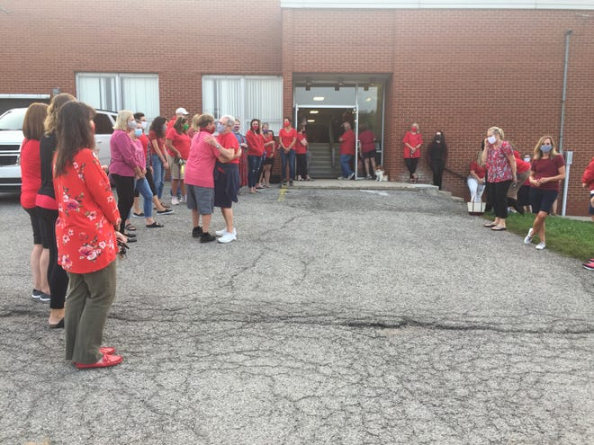 Members of the teachers' union for Lexington Local Schools gathered before Wednesday's board of education meeting.