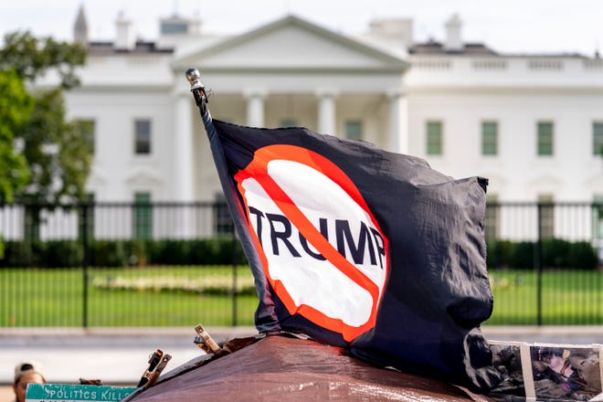 An anti-Trump flag is visible in Lafayette Square outside the White House on the fourth night of the Republican National Convention  Aug. 27, 2020, in Washington.