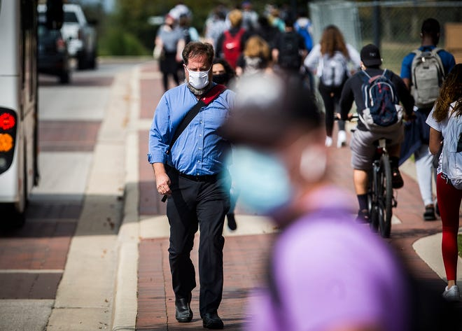 Students and staff walk along McKinley Avenue on Ball State's campus Thursday, Sept. 17, 2020.
