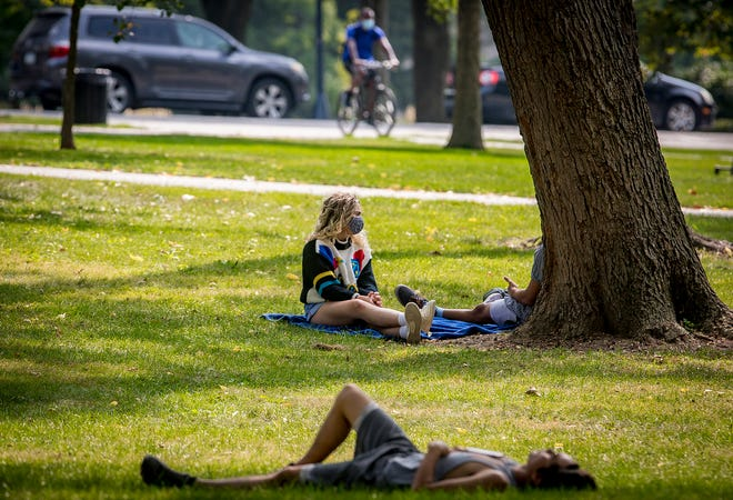 Students lounge on the quadrangle at Ball State University on Thursday, Sept. 17, 2020.