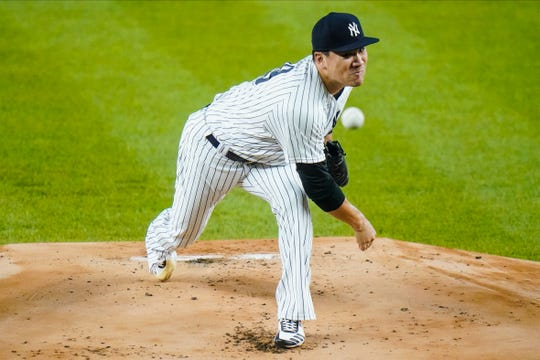 Masahiro Tanaka delivers a pitch during the first inning against the Toronto Blue Jays.