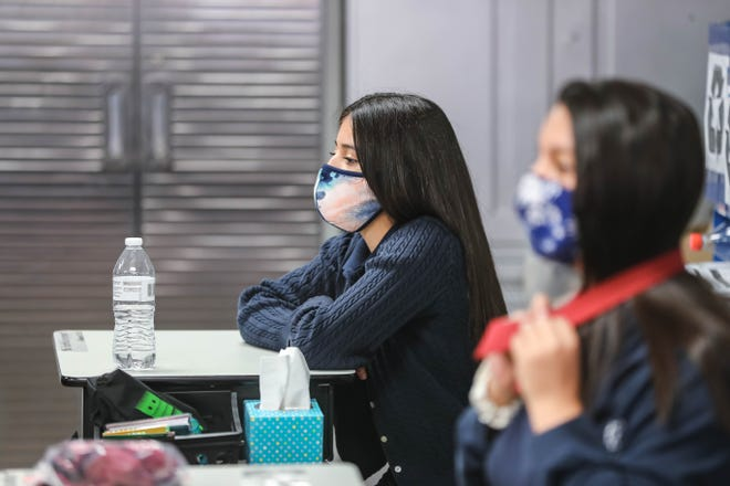 Students and teachers wear masks and socially distance at Las Cruces Catholic School in Las Cruces on Thursday, Sept. 17, 2020.