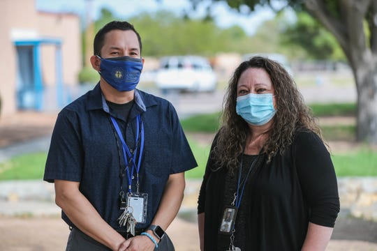 Adrian Galaz, principal of Las Cruces Catholic School and Windy Drake, assistant principal stand in from of Las Cruces Catholic School in Las Cruces on Thursday, Sept. 17, 2020.