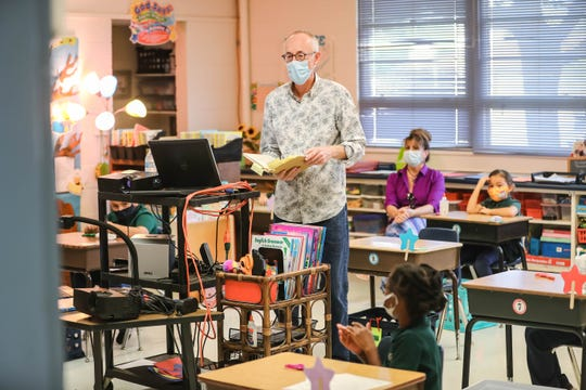 Raul Dorn teaches art to first-grade students as students and teachers wear masks and socially distance at Las Cruces Catholic School in Las Cruces on Thursday, Sept. 17, 2020.