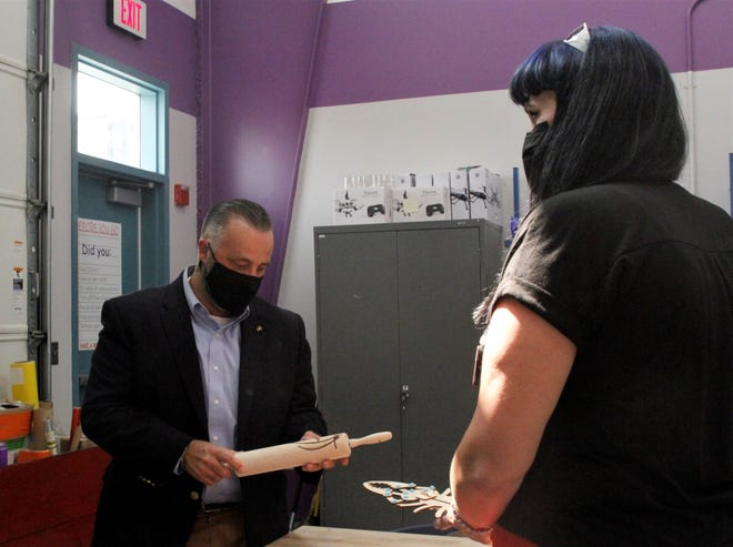SBA Regional Administrator Justin Crossie looks at an item made at the San Juan College Makers Space during a tour, Wednesday, Sept. 16, 2020, in Farmington.